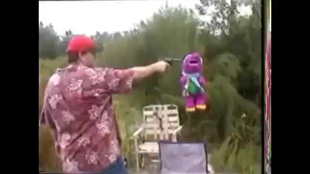 """Barney being executed by Americans. .. """"Government can I have gun"""" """"To protect?"""" Actually shoots stuffed animals"""
