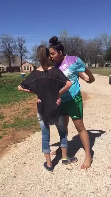 Two girls fighting. .. and this is what turns people into racists