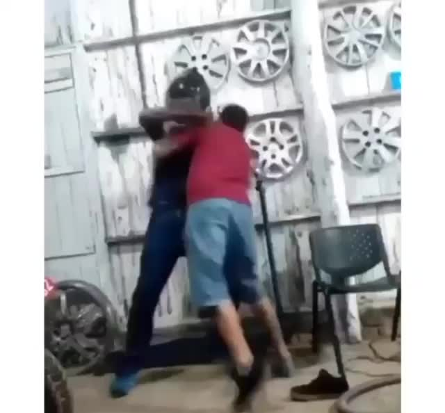 Mind Riot. Ah yes, the helmet punch. So you can break your hands fighting... Gotta say he was tossing that guy around