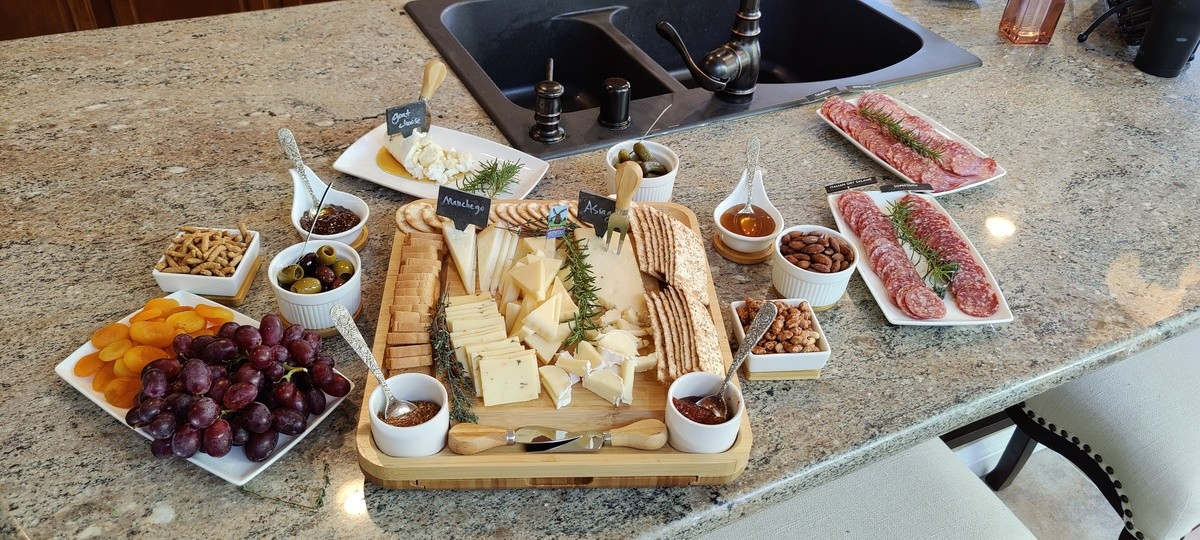 """Cheese plate and charcuterie. join list: QuixoticMeals (123 subs)Mention History.. Left to right Candy grapes Apricots Sesame sticks Marinated olives Homemade fig jam Goat cheese with honey Melba mini toasts Homemade """"Caviar"""" mustard"""