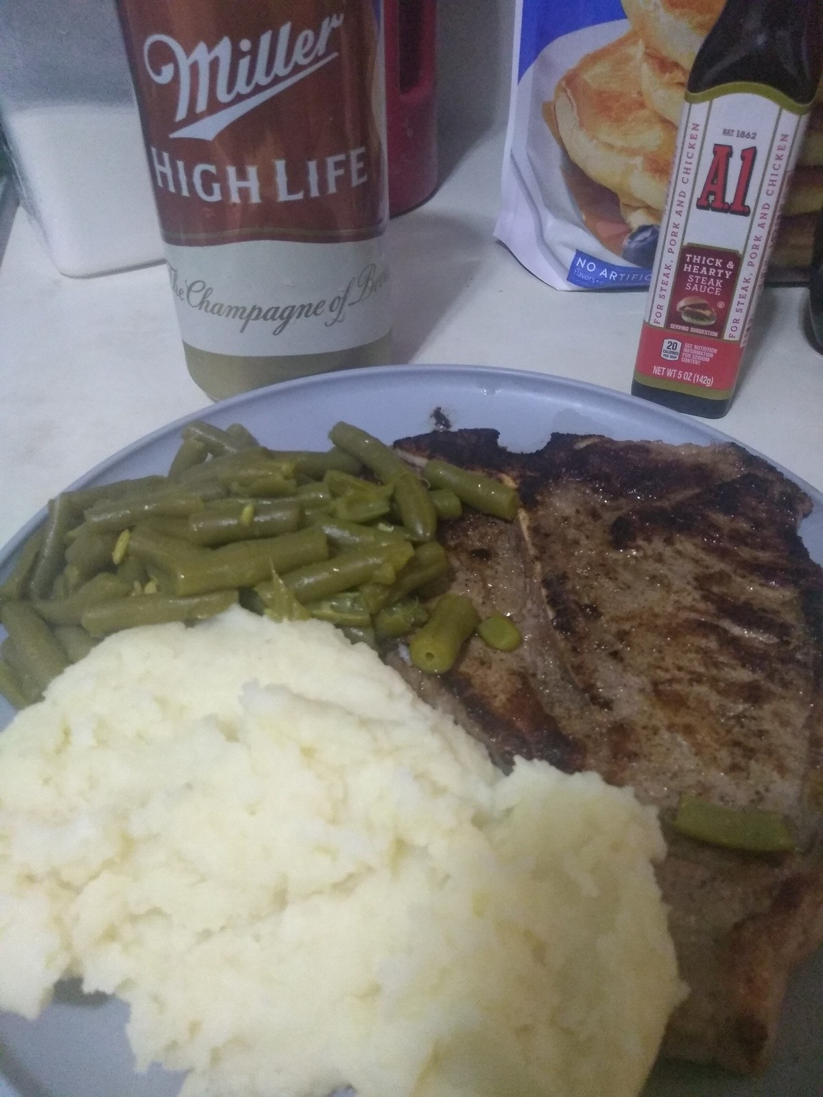 Dinner. T bone with mash potatoes and buttered green beans.. I've never seen a T-Bone Steak that I didn't want to eat until now. Over-cooked, under-seasoned meat paired with canned veggies and dry mashed potatoes. at leas