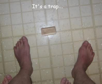 DONT PICK IT UP! ITS A TRAP!. Look around his feet..... There's even toes behind him!!! DON'T DO IT JOHNNY!!!!