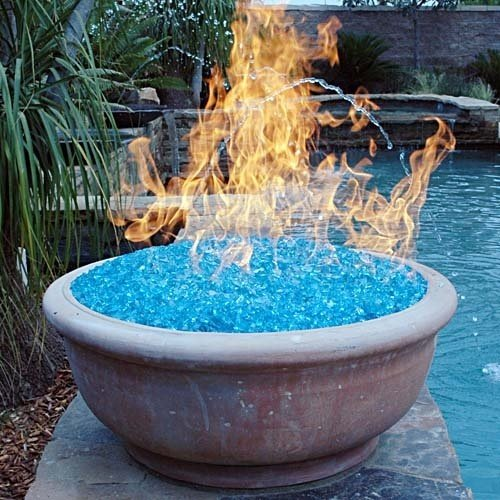 Fire Glass. Fire glass produces more heat than real wood, and also is environmentally friendly. There is no smoke, it's odorless and doesn't produce ash. You ar