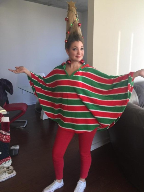 How my girlfriend showed up at work for the ugly sweater contest. .. But thats a poncho not a sweater... and the sillyness is on her hair not the poncho...