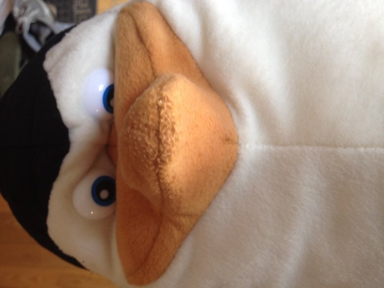 My daughter got a stuffed penguin today. It's face haunts me in my sleep. Sorry, I don't know why it uploaded sideways. Still creepy as .