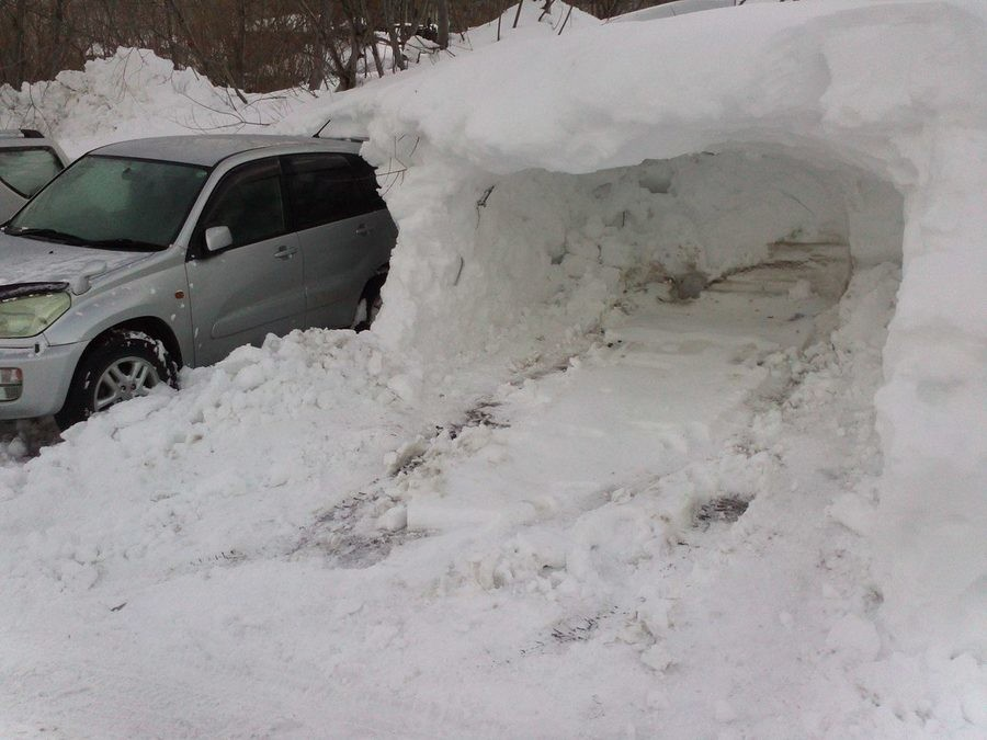 Natural built garage with snow. .. How to get a new car: 1. Park here 2.Wait