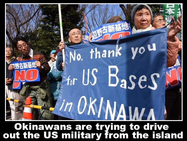 Okinawans protest. . Okinawans are tr ing to drive out the US military rem the island. No, thank YOU. Japs are so polite.