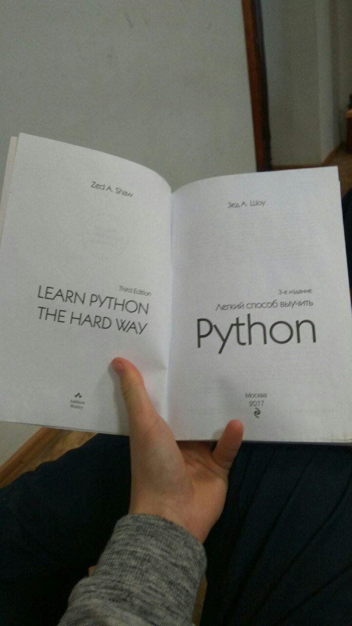 Programming in Python. I know that learn the hard way is an idiomatic phrase, but still... You make every lesson convoluted, drawn out, and referencing info the student doesn't have yet