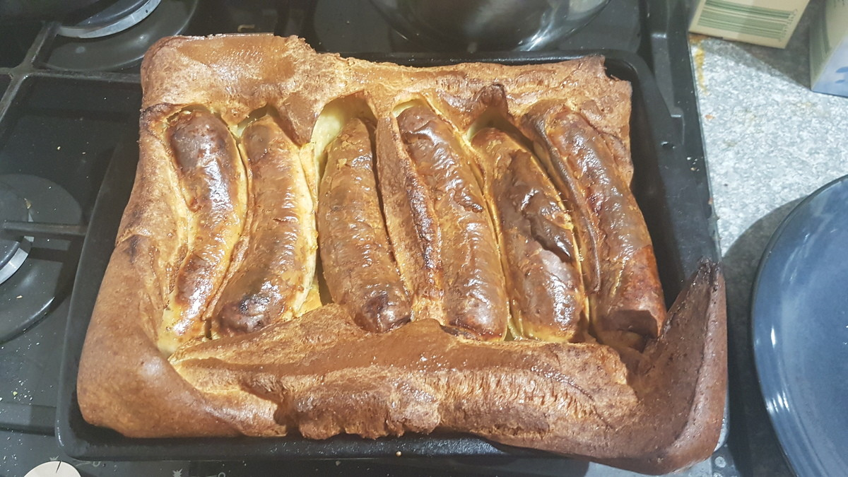 Proud of my Toad in the hole. -Chilli sausages -peas and sweetcorn on side -plenty of gravy, of course -175ml of milk -140g of plain flour -2 medium eggs cook 2