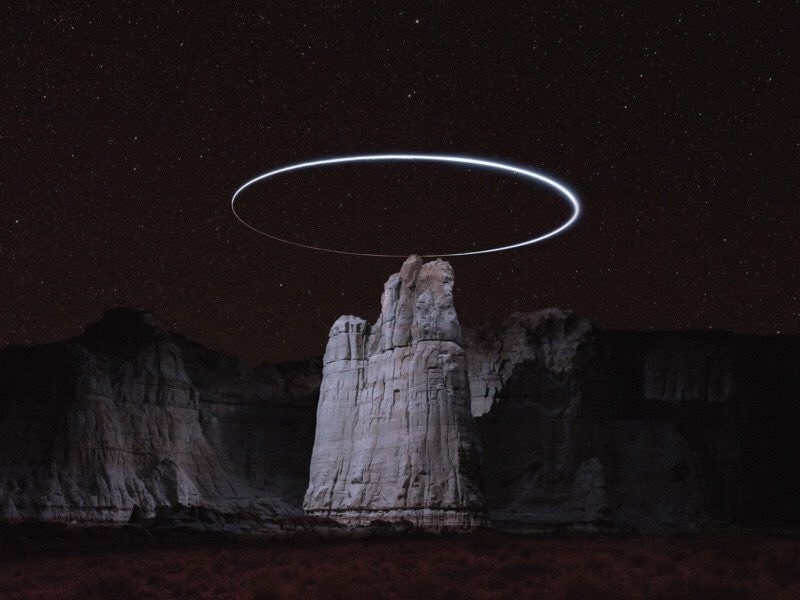 Reuben Wu. He uses drone mounted lights to illuminate landscapes for unique art.. holy mountain was a movie!