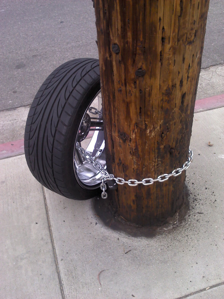 Stolen Car?. .. What a stupid noob. I mean if you want to stop your telephone post from being stolen, chain it to a car.