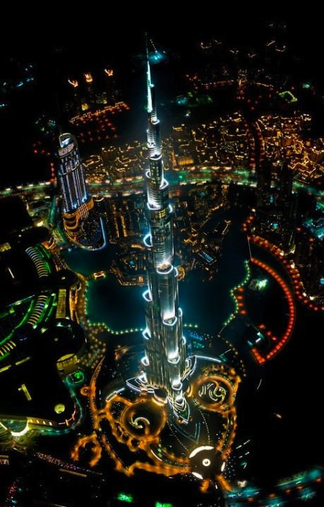 TALLEST BUILDING IN THE WORLD. VIEWED FROM A HELICOPTER AT NIGHT.. Compensating? Compensating.