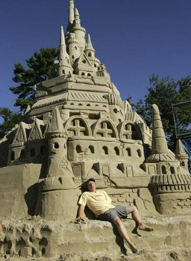 Tallest sand castle ever!. Thats a of sand!.. i like snad castles they make me happy