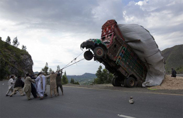 Taming wild trucks in pakistan. They are doing it right.. The ambulances will just have to wait their turn...