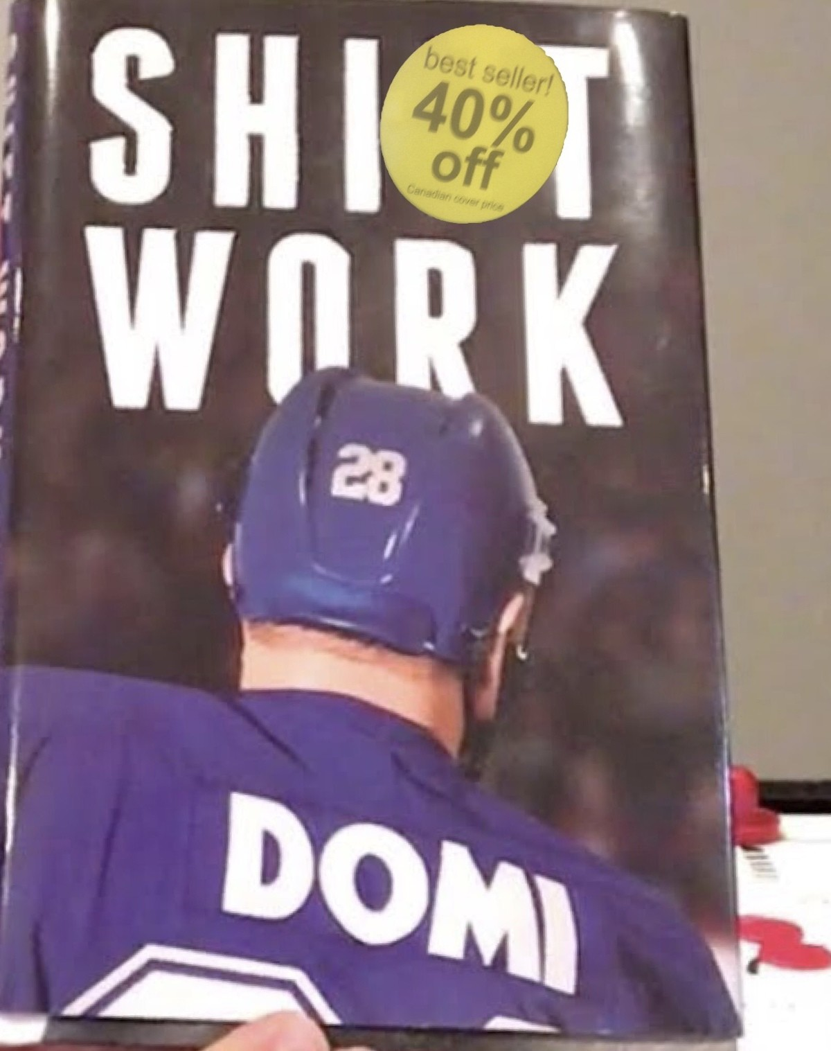 The book store workers knew what they were doing.... Domi was a hockey player (one of the worst in the league).. that's a shop.