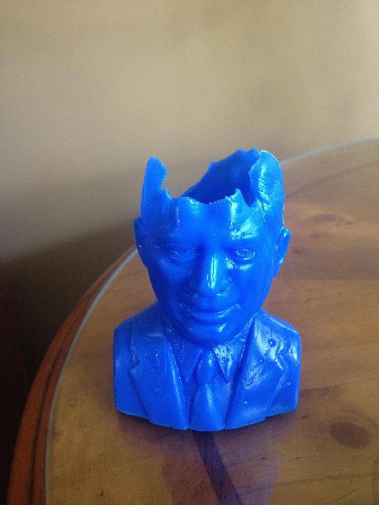 the irony. My plastic-mold of JFK came out of the machine like this..... coincidence