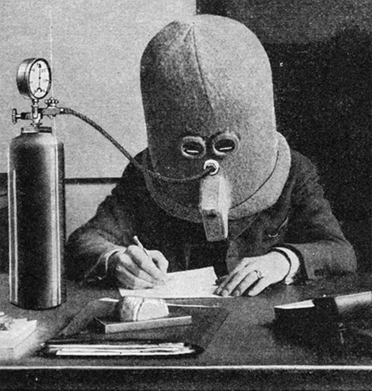 The Isolator Helmet. Innovative helmet designed by Hugo Gernsback eliminates distractions and helps people concentrate on their work. The Isolator Helmet blocks