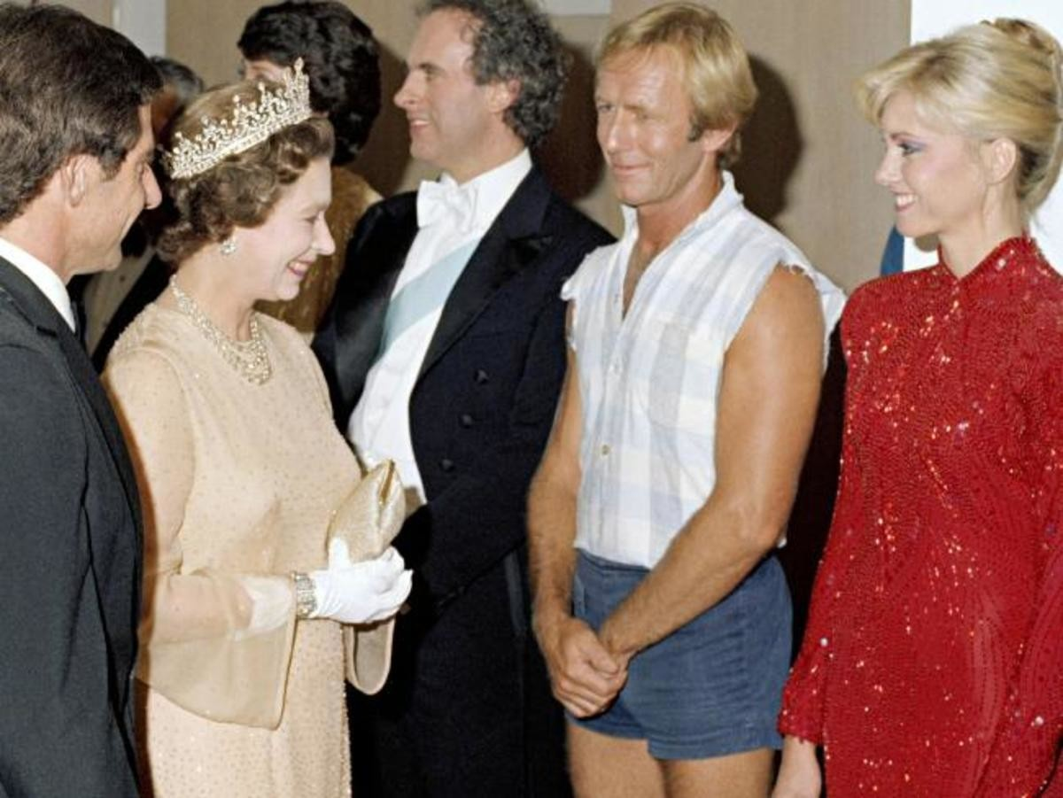 The most Australian man ever, Paul Hogan, meeting the Queen. .. And she is absolutely chuffed he's there. That's a smile you couldn't fake.