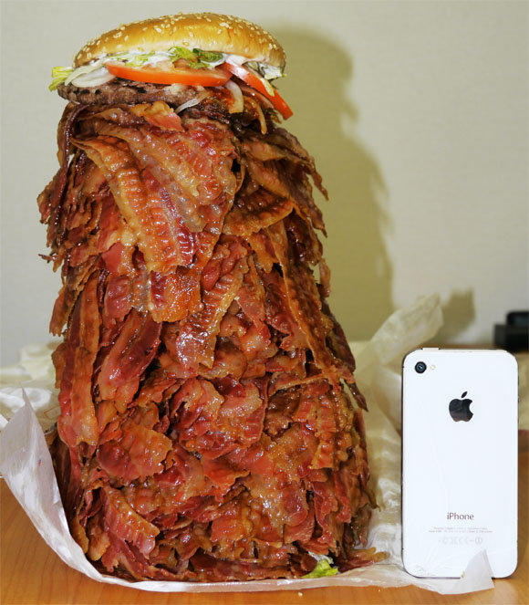 The Thousand Piece Bacon CheeseBurger. Says it all.. Cool! That piece of bacon won an iPhone by being the thousandth visitor to the sandwich!
