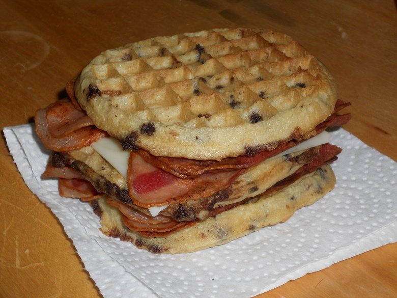 The BaconWaffler. A double-decker sandwich composed of 6 slices of Turkey-Bacon, 1 slice of mozzarella cheese and 3 Chocolate-Chip Eggos. (For the record, this
