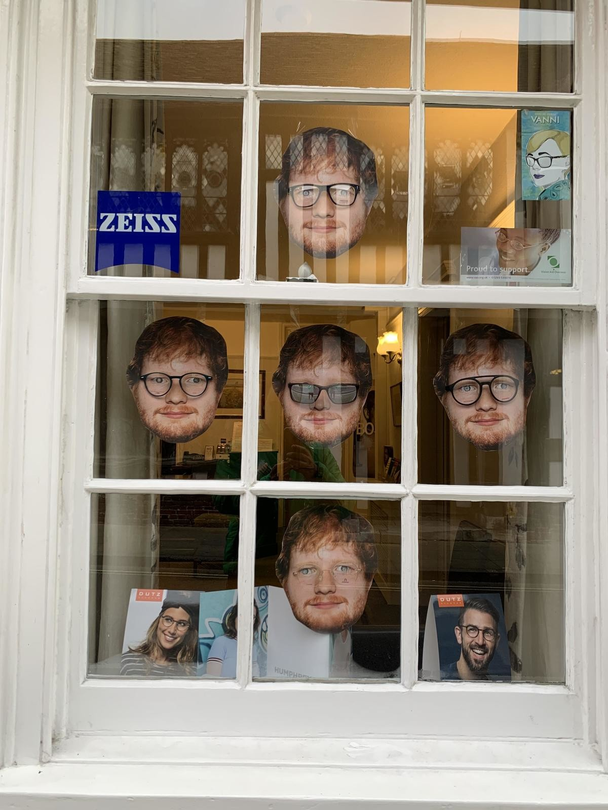 """This optician's window display in Ipswich.. .. I would just turn right the around and find another optician. It'd be a bit embarassing to have """"Murdered by an eye doctor, the wuss."""" on my grave."""