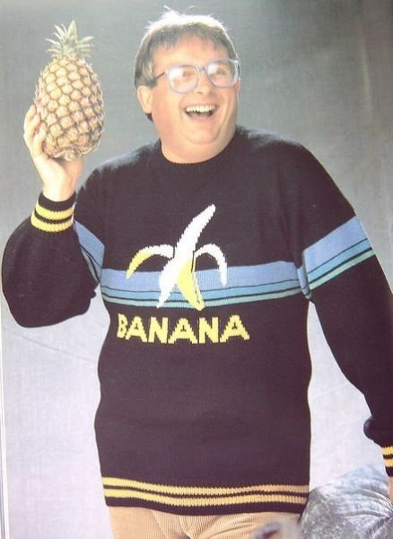 This picture makes no sense. .. Obese Bill gates with a pineapple.