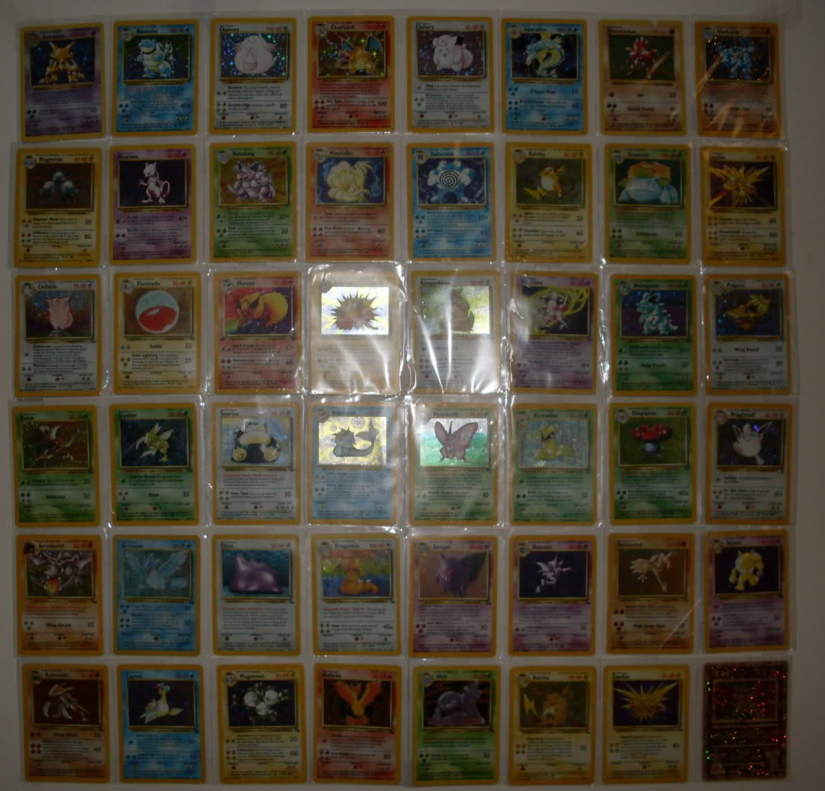 Tribute to my childhood. I'm pretty proud of this. Every holo from the first three sets - plus Ancient Mew because that card is awesome, also 47 cards don't mak