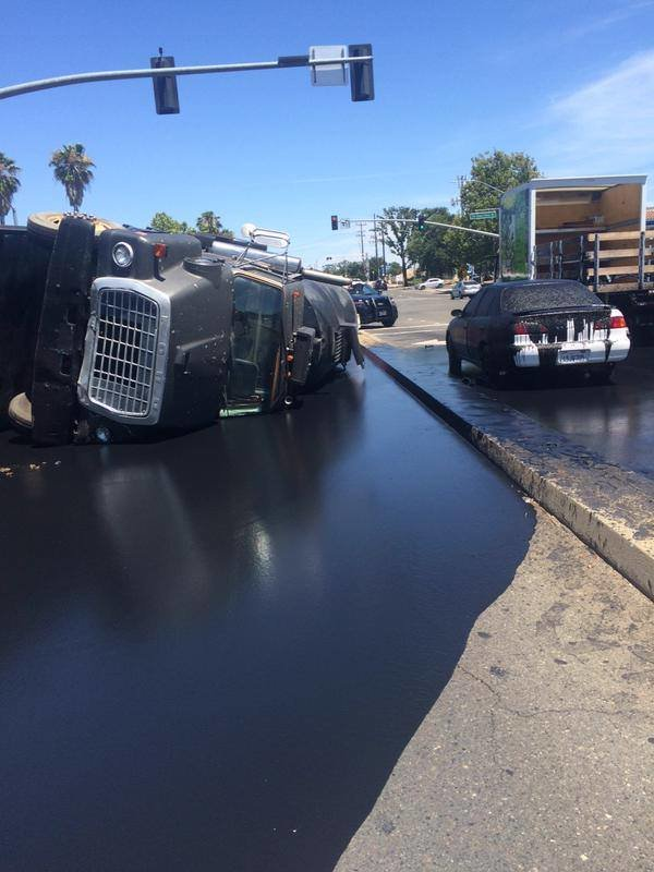 Truck with asphalt sealant tipped over. .. It was clearly his phalt
