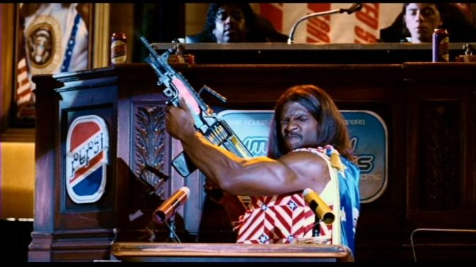 Trumph Is Running For President. I Guess Its Only A Matter Of Time Now...... WTF?.....lets summarize, i see a big black dude in court (not that odd really), wearing a wig and dress, and drawing a saw light machine gun. let me reiterate..