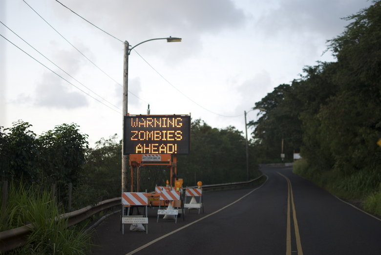 Zombies.. there have been hackings in the past months on these signs, never knew it would happen near me!. RHEAD!